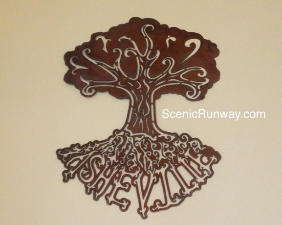 Bronze Wall Decor made by a local Asheville Artist.  Design is of a tree with roots that spell out Asheville.  It looks amazing hanging on my family room wall.